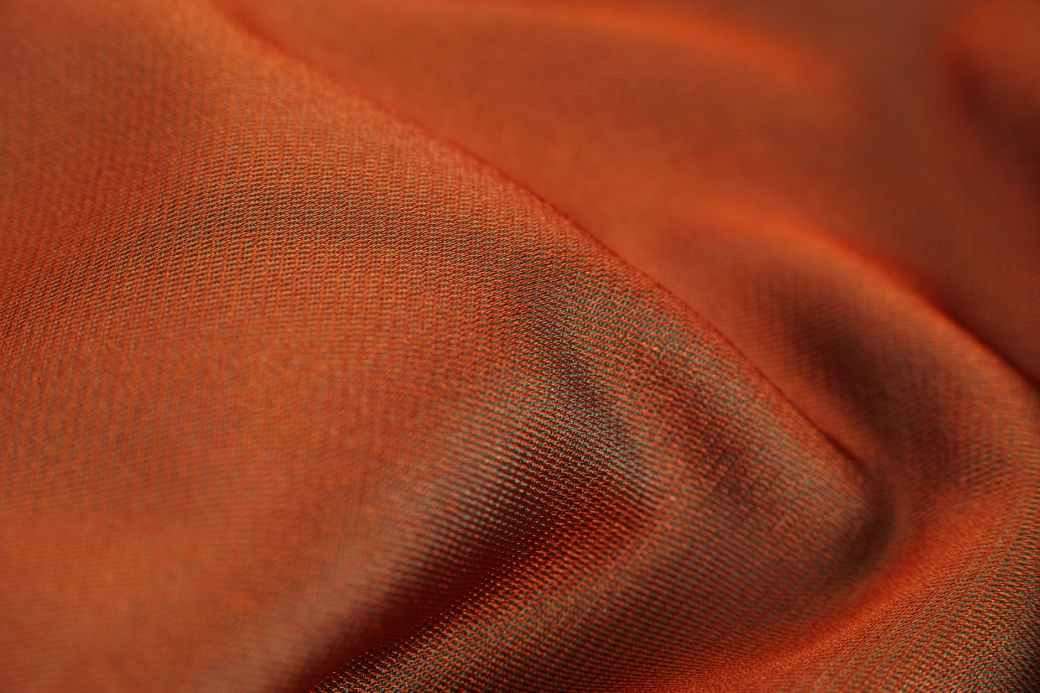 closeup photo of orange cloth