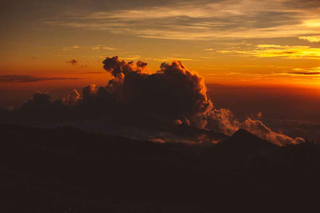 breathtaking cloudy sky over mountainous in sunset