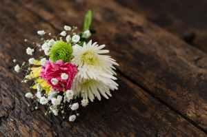 bouquet of delicate flowers on wooden bench